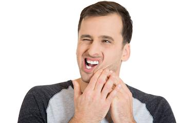 Man with tooth pain from teeth grinding and TMJ near 68005